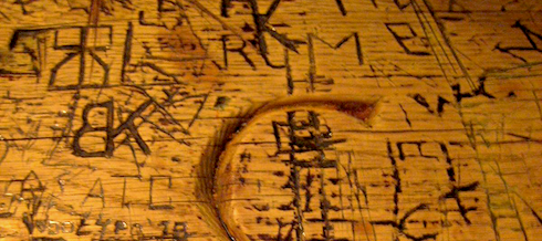carvings on the tables at the Nassau Inn