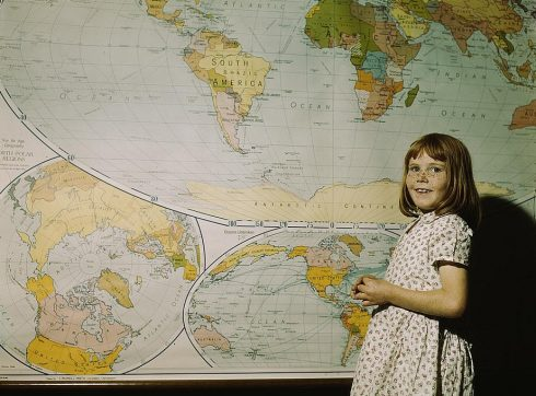 School_girl_in_front_of_a_map